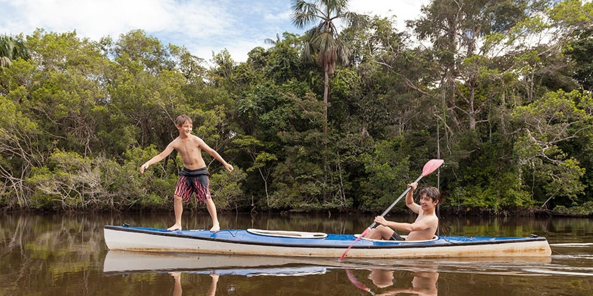 kids kayaking in the Amazon