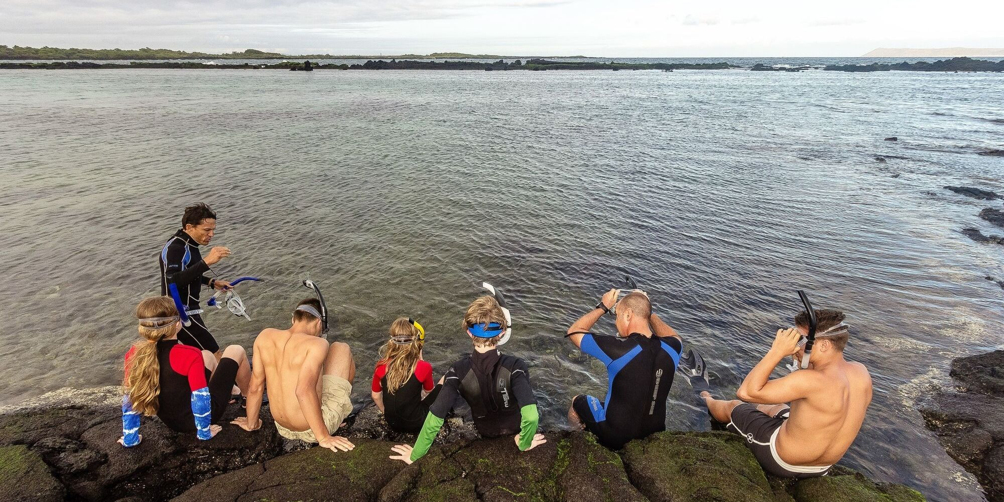 Family snorkeling in Galapagos Islands